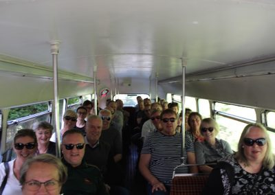 Large group tour on vintage london bus